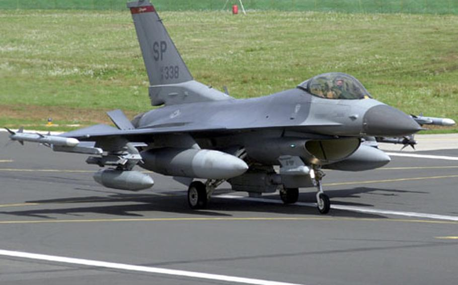A U.S. Air Force F-16CJ rolls down the runway after landing at Spangdahlem Air Base, Germany on Thursday.