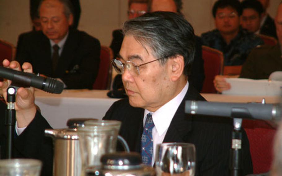 Okinawa Gov. Keiichi Inamine addresses the Tripartite Liaison Committee Friday.