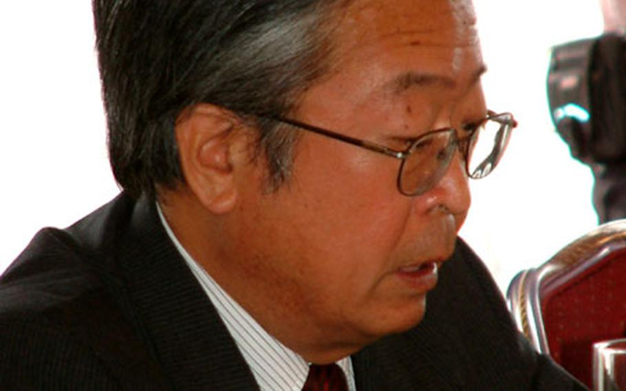 Saadaki Numata, ambassador in charge of Okinawan affairs, addresses the Tripartite Liaison Committee Friday.