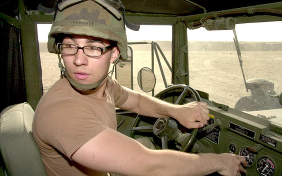 Spc. Seid Tanovic, 20, a native of Bosnia and Herzegovina, backs up his M818 five-ton truck during a recent truck rodeo.