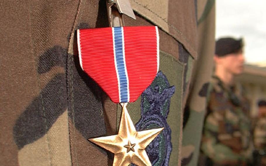 Air Force Master Sgt. Daniel Arvin's newly awarded Bronze Star Medal stands in stark contrast to his subdued camouflage uniform. Arvin received the Bronze Star for his actions while stationed in the Middle East.