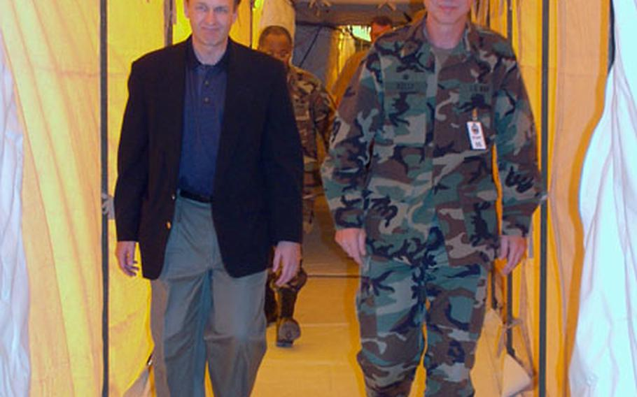 Capt. Pat Kelly, commanding officer of Fleet Hospital Eight in Rota, Spain, gives Dr. William Winkenwerder a tour of the fleet hospital. The tent facility has treated more than 500 patients since the war in Iraq began March 20.