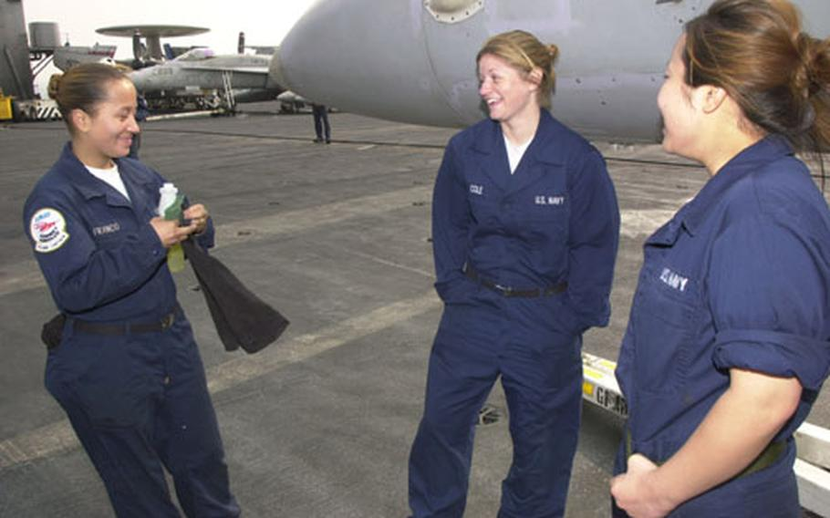 """Jessica Franco (l-r), Andrea Cole, and Youliah Kwon, had reason to laugh and smile Saturday morning. The airman aboard the USS Carl Vinson were looking forward to trying some sushi and getting """"off this boat"""" during a port call at Yokosuka Naval Base, Japan."""