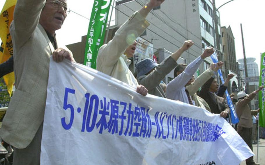 Japanese demonstrators chant slogans protesting the arrival of the USS Carl Vinson, the war in Iraq and the presence of U.S. Navy forces in Japan.