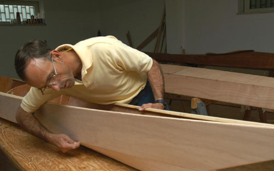 Capt. Darrell Van Hutten shows where epoxy seals together panels to create a kayak.