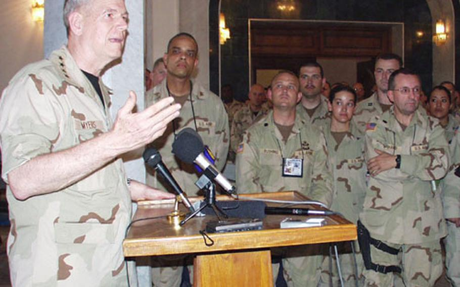 Gen. Richard D. Myers, Chairman of the Joint Chiefs of Staff, talks with troops at V Corps headquarters in Baghdad on Monday.