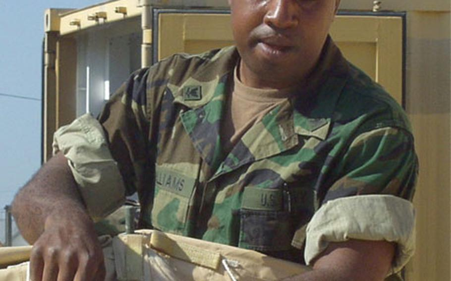 Petty Officer 3rd Class Zealous Williams helps dismantle a tent Friday at Naval Station Rota, Spain.