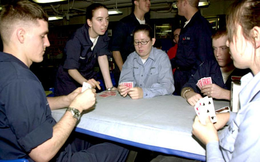 Sailors on board the USS Carl Vinson played a game of spades Friday night on the eve of making a port call in Yokosuka, Japan. About a quarter of the crew stays on the aircraft carrier during a liberty stop.