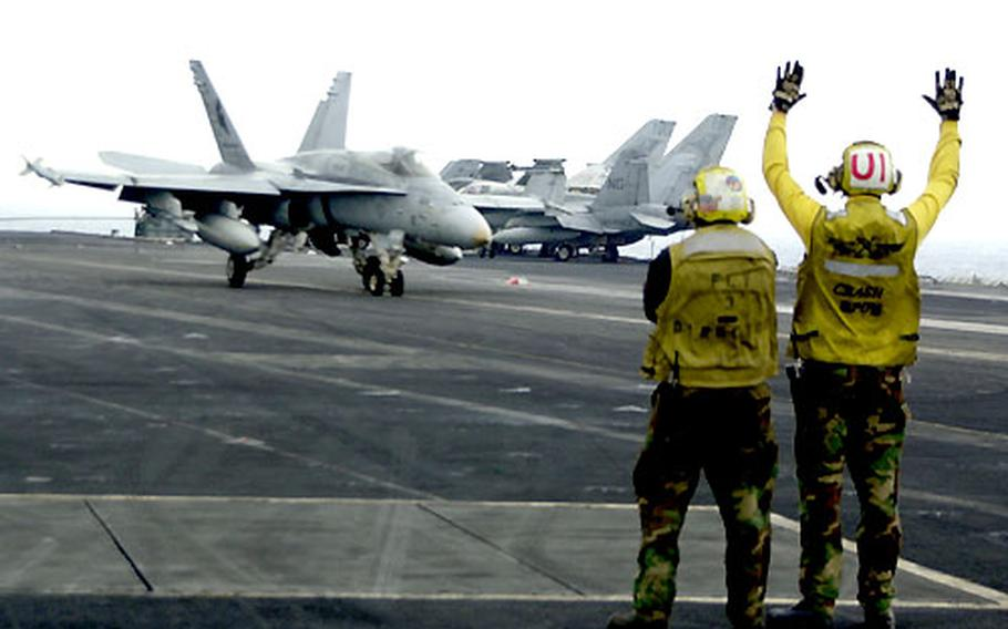 An F/A-18 Hornet makes a successful landing on the USS Carl Vinson during recent flight operations.