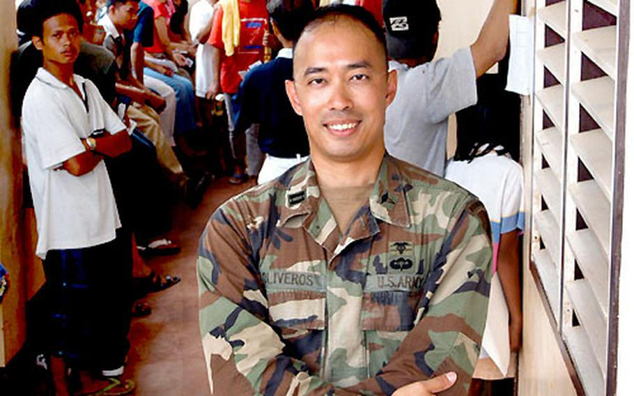 U.S. Army Capt. Ed Oliveros is a native Filipino who returned to his homeland this month to lead the U.S. humanitarian and civic mission in the southern Philippines. He's standing at a Medical Civil Action Project near Zamboanga City.
