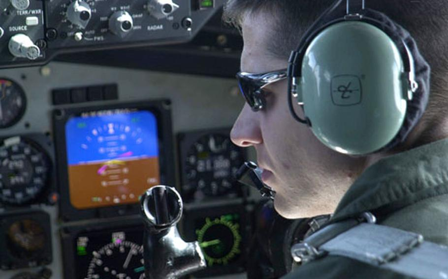 1st Lt. Jeff Guttman keeps his eyes on readouts and dials in the cockpit of a KC-135R tanker flying over the Sea of Japan Tuesday during Cope North exercises.
