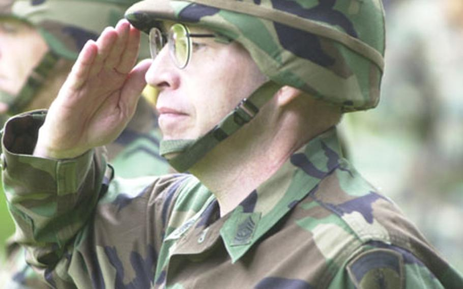Command Sgt. Maj. David Lady fires off a last salute as command sergeant major of U.S. forces in Europe on Thursday afternoon as he passes the leadership mantle of the top enlisted soldier in USAREUR to Command Sgt. Maj. Michael L. Gravens.