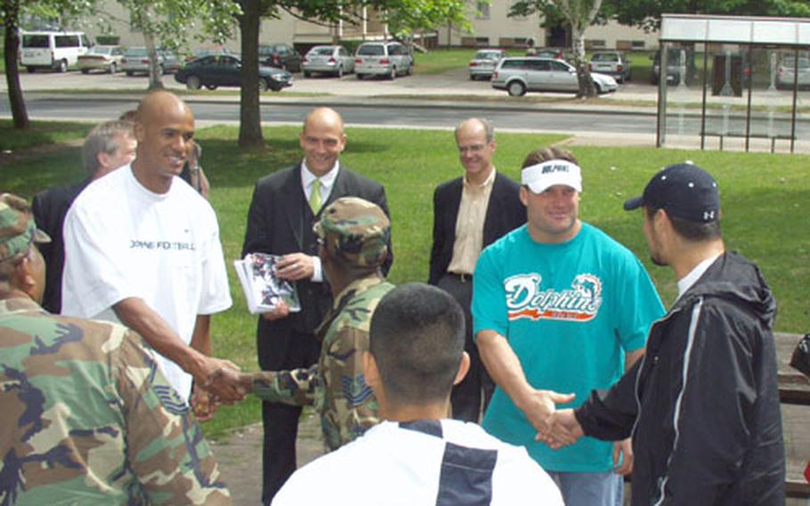 Zach Thomas and Jason Taylor, two Miami Dolphin football players, visited troops and family members at the Rhein-Main Air Base Thursday.