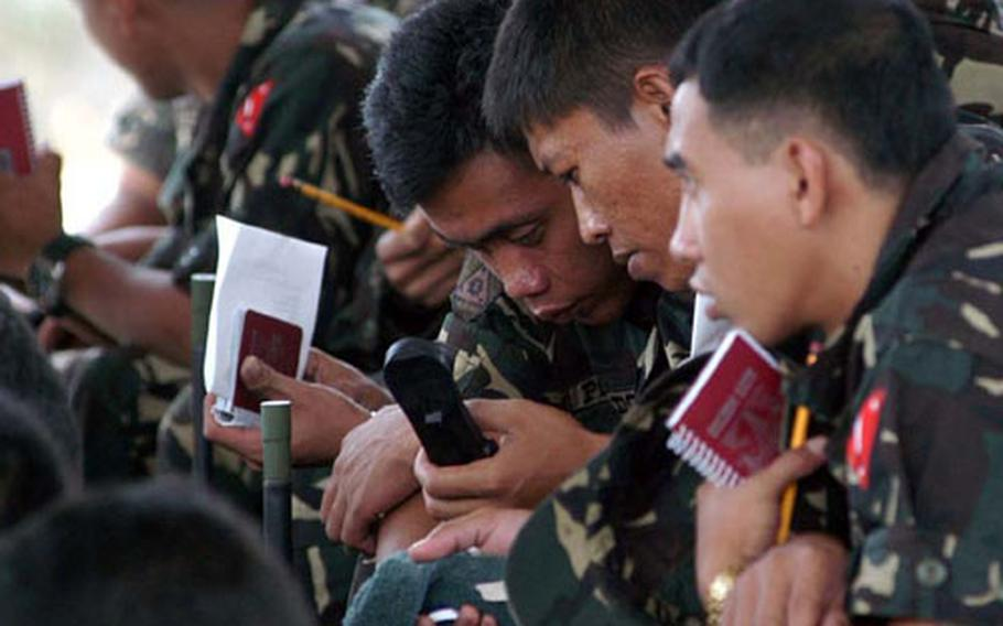 Philippine servicemembers learn communications using U.S.-purchased radios as part of a Security Assistance Module in the southern Philippines.