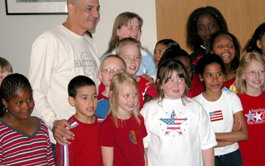 Sgt. Felix Martinez poses Friday with fourth-graders from Kaiserslautern Elementary School at Landstuhl Regional Medical Center.