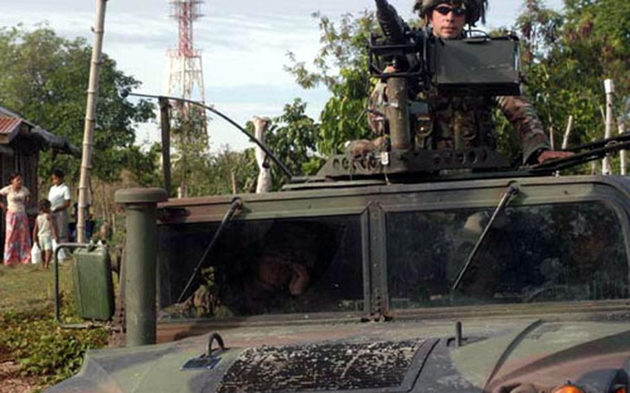 Armored humvees and heavily-armed Marines patrol the village near a Medical Civil Action Project, or MEDCAP, held by U.S. and Philippine forces near Zamboanga City in the Southern Philippines. Classified by President Bush as part of the War on Terror, the southern Philippines is one of the most hostile and dangerous places for U.S. forces in Asia.