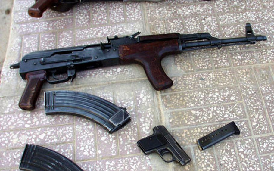 A few of the weapons confiscated Saturday by 3rd Infantry Division soldiers during traffic stops in Baghdad.