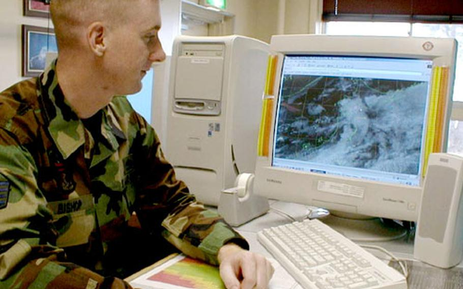 Staff Sgt. Brian Bishop, an Air Force weatherman at Misawa's 35th Operational Support Squadron weather flight, looks at an image from a Japanese satellite Monday of a large portion of northern Japan.
