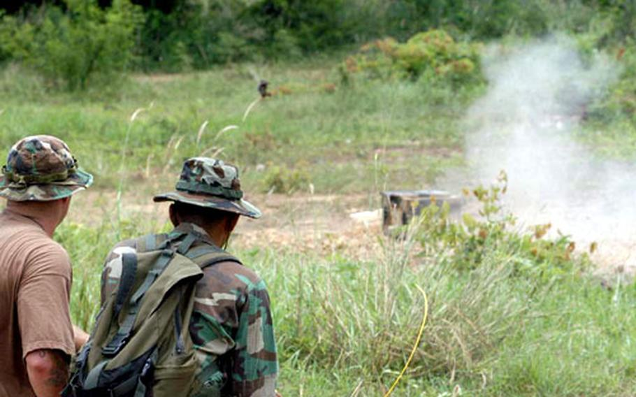 U.S. Navy Explosive Ordnance Disposal Mobile Unit 5 personnel and Royal Thai servicemembers blow up a potential explosive Saturday as part of a mine-disruption demonstration during Cobra Gold in Thailand.