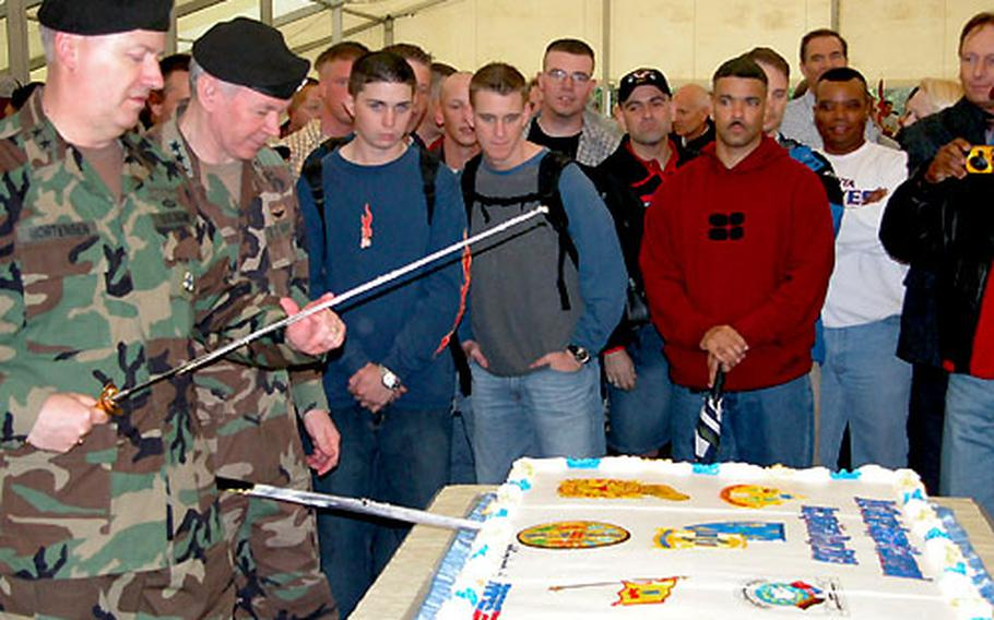 Maj. Gen. William E. Mortensen, left, and Lt. Gen. Michael Dodson cut the cake Thursday at a celebration at the Rhein Ordnance Barracks, Kaiserslautern.