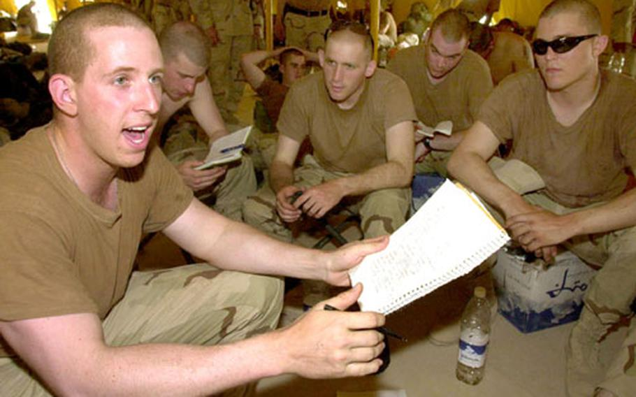 Pfc. Dennis Wells, left, leads soldiers from 1st Battalion, 36th Infantry Regiment through Arabic lessons at Camp Udairi, Kuwait.