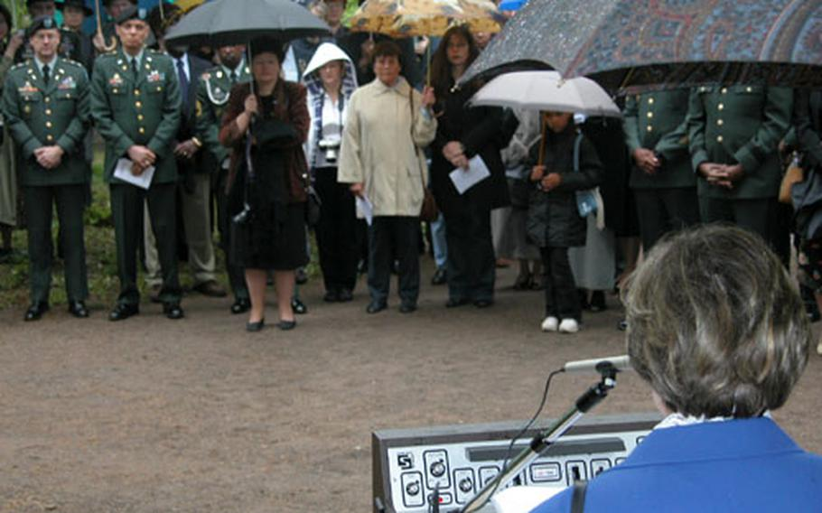 Stefanie Merai, German president of the German American International Women's Club, addresses the crowd at the May 17 Kindergraves ceremony. The ceremony was to honor the memories of the 451 infant children of U.S. servicemembers buried at the site in the Kaiserslautern cemetery.