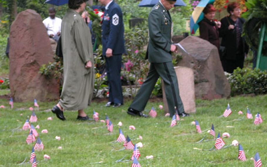 Spectators walk among the children's graves following the May 17 ceremony to honor the memory of the 451 infants of U.S. servicemembers buried at the Kaiserslautern cemetery.