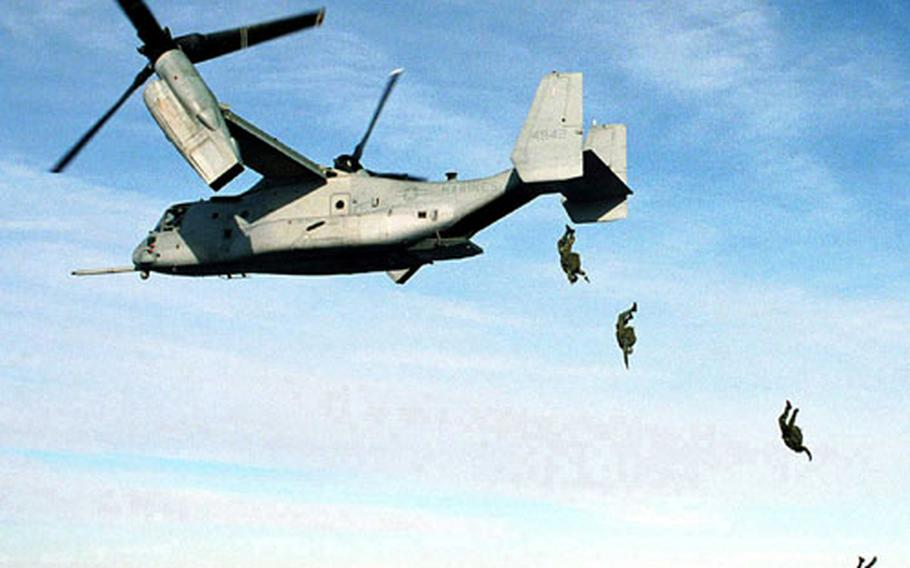 U.S. Marine Corps parachutists free fall from an MV-22 Osprey at 10,000 feet above the drop zone at Fort A.P. Hill, Va. on Jan. 17, 2000. The Marines from the 2nd Reconnaissance Battalion, 2nd Marine Expeditionary Force, Camp Lejeune, N.C., became the first to deploy from the Osprey. Twenty-four successful jumps were recorded under the supervision of the U.S. Army Operational Test Command and the Marine Corps Systems Command to qualify the V-22 for parachute service.