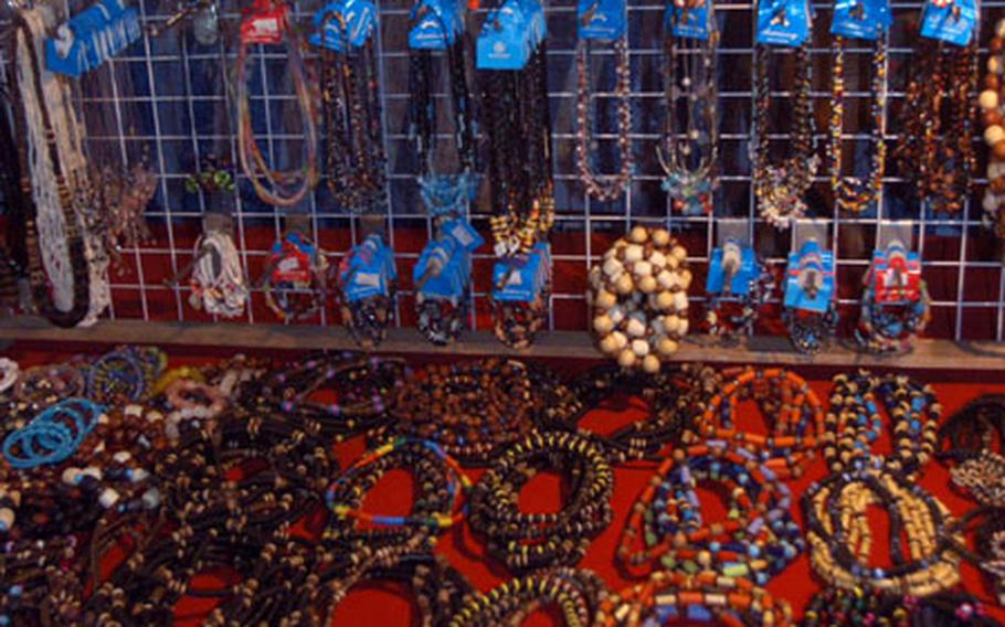 Servicemembers load up on trinkets and jewelry like these pieces for sale at a market outside the Ambassador City Hotel near Pattaya, where Gobra Gold is headquartered.