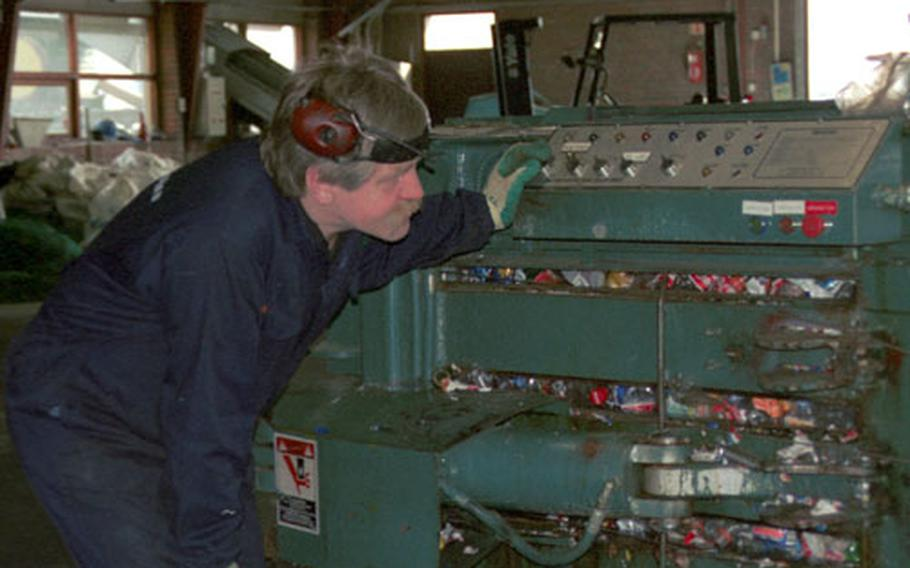 A worker at the Endurvinnslan Recycling Plant in Reykjavík checks the machine responsible for compacting all the plastic bottles collected. Once enough bottles are compressed inside, he will insert metal bindings into the open slots to help tie up the bundle and get it ready to be pushed out of the machine. Once the bottles are packaged, they will be shipped out of the country and eventually be used in the manufacturing of clothing.