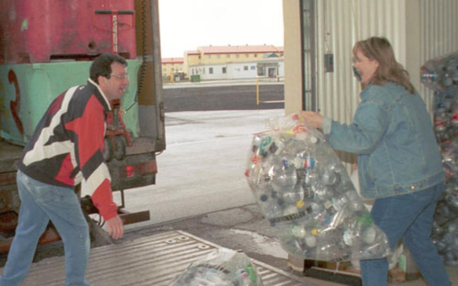 Manuel Eutrambasaguas, left, a recycling technician at the Recycling Center and his co-worker, Michelle Buchanan, the center's recycling supervisor, load up a truck with cans and bottles collected from the previous week. A truck comes every Tuesday morning from the Endurvinnslan recycling plant in Reykjavík to pick up the items.