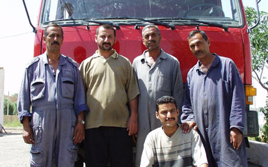 Members of the Al Baya Fire Station in Baghdad, from left: Ibrahim Awad, Mushtak Fadhil, Ahmad Attyah, Hussain Khallil and Mohamed Swadi. The firefighters are still working, without pay, fire suits or enough trucks.