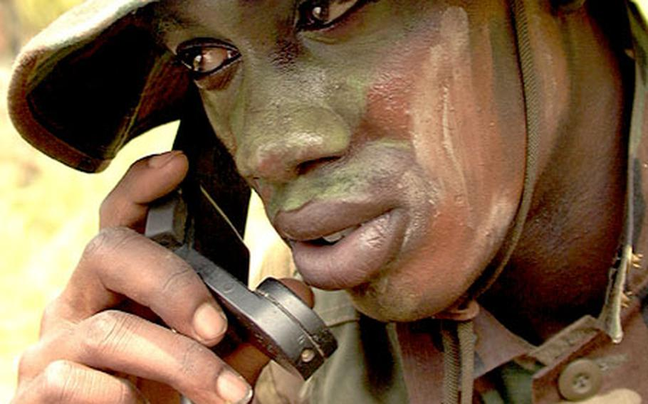 Marine Lance Cpl. Sharnell Carter listens in on a radio call during a break in recent training at Okinawa's Camp Hansen.