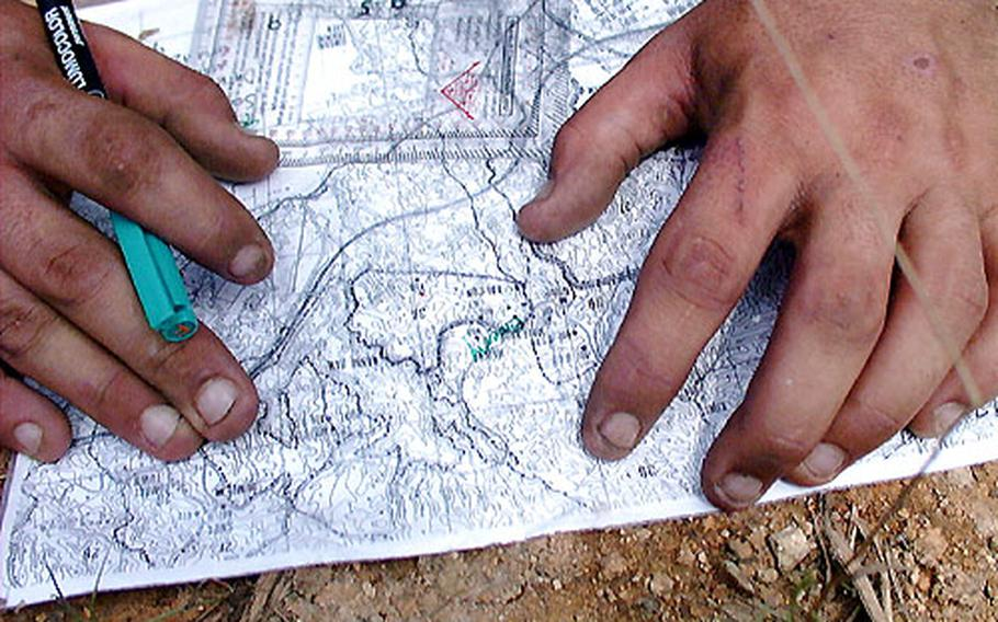 Map sheets and alcohol pens park the route toward enemy contact.