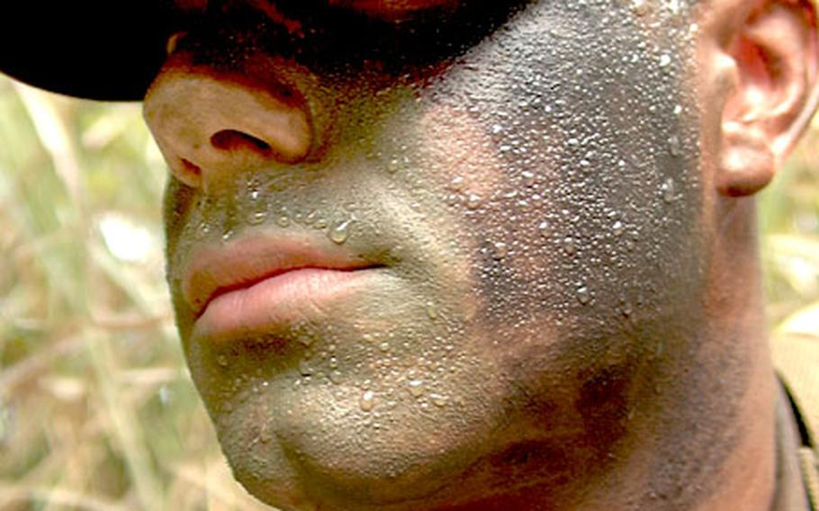 Sweat beads up on Marine Pfc. Rusty Thrasher, a Stinger missile gunner, during training at Camp Hansen.