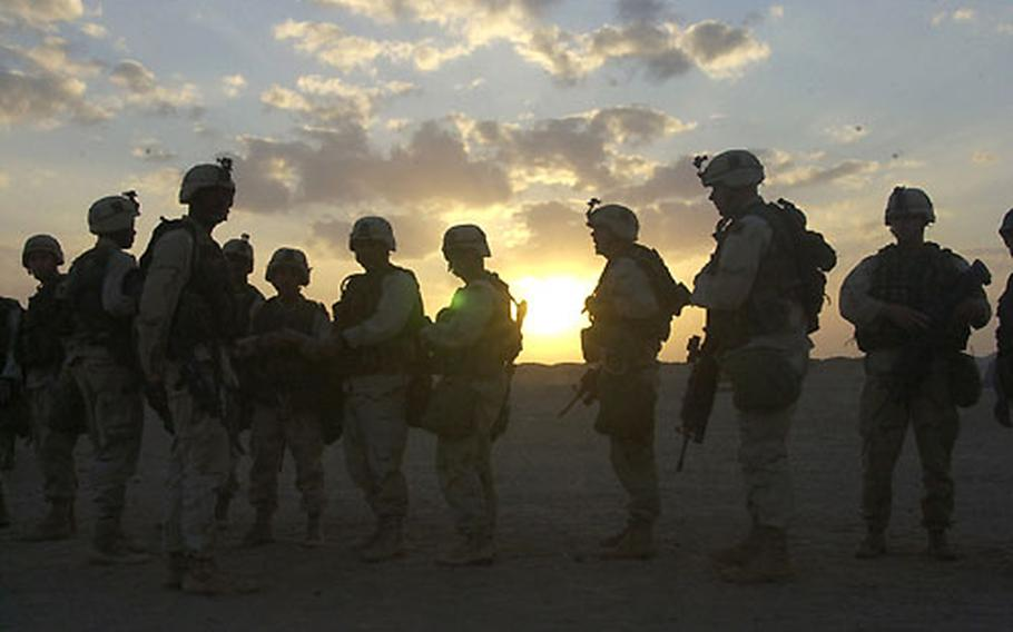 Troops from Company B, 1st Battalion, 15th Infantry assemble during the march north to Baghdad on March 23.