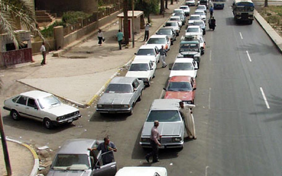 Cars line up for miles to get cheap gasoline at a station in Mansur. Those who don't want to wait for the limited supply pay five times the price on the black market.