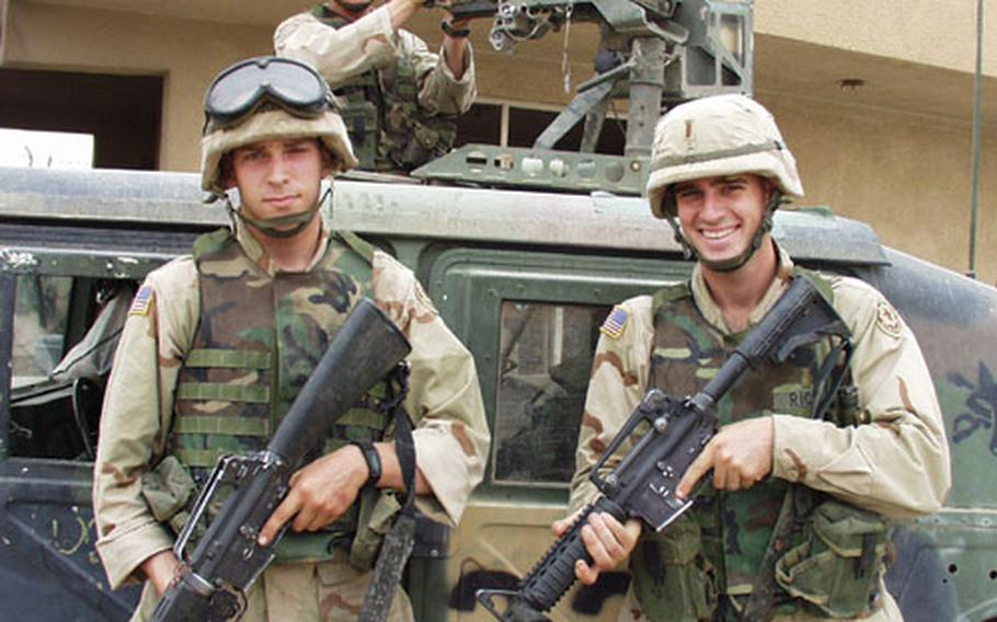 Pfc. Jason Johns (left), Sgt. Daniel Hicks, manning the M2 gun, and 2nd Lt. Chris Ricci get ready to patrol Thawra, one of Baghdad's toughest neighborhoods. The soldiers are from 2nd Armored Cavalry Regiment, 2nd Squadron, Fox Troop.