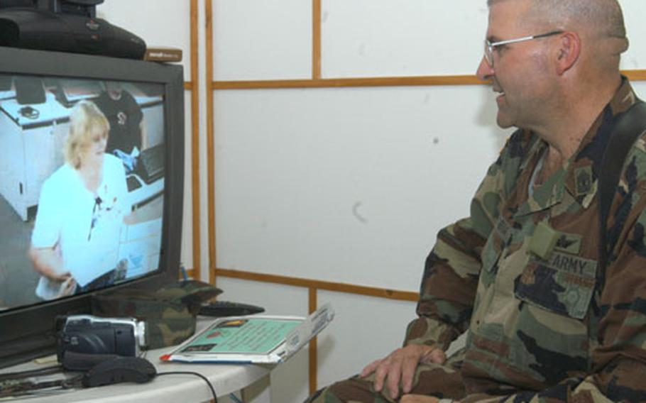 First Sgt. Delbert Jacobia of 1st Battalion, 108th Aviation Regiment, and his wife, Karen, renewed their wedding vows via video teleconferencing on their 30th wedding anniversary Monday. The couple, who now live in Salina, Kan., got married when Jacobia came back from a deployment to Vietnam.