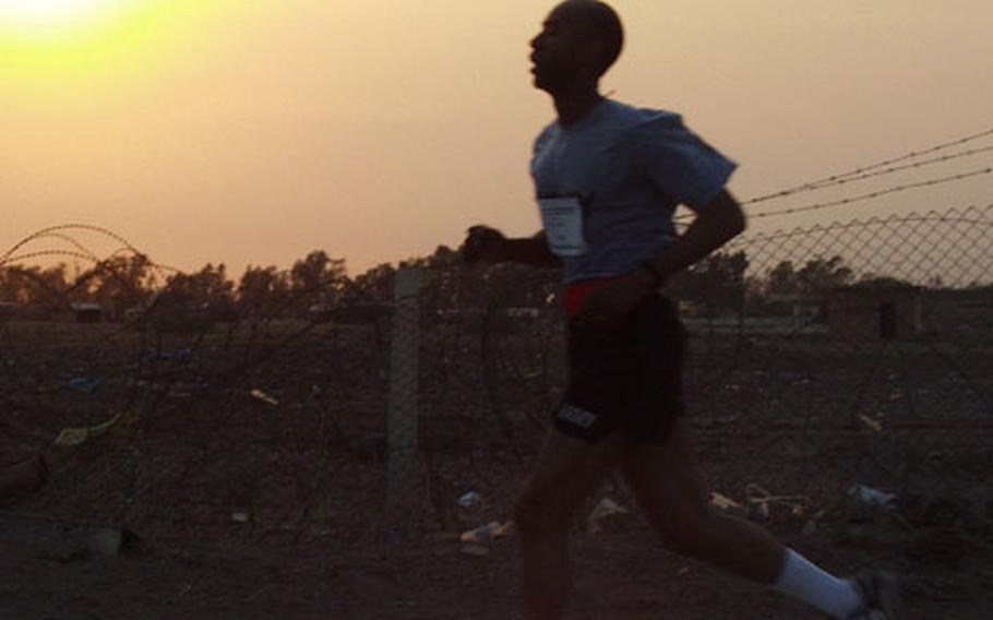 Reginald Smith, the command sergeant major of the 2nd Battalion, 501st Aviation Regiment, nears the end of his 5-kilometer run Friday at Baghdad International Airport. Smith's battalion sponsored the race, which started a day of sports, food and general celebration of the Fourth of July.