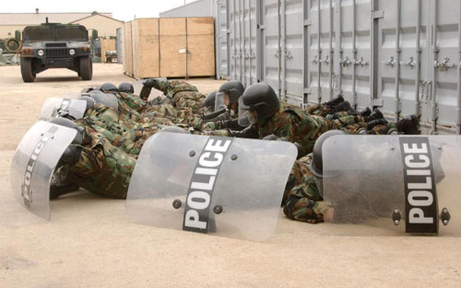 Members of a base protest operations squad practice what they would do in the event a protester had a gun during recent training.