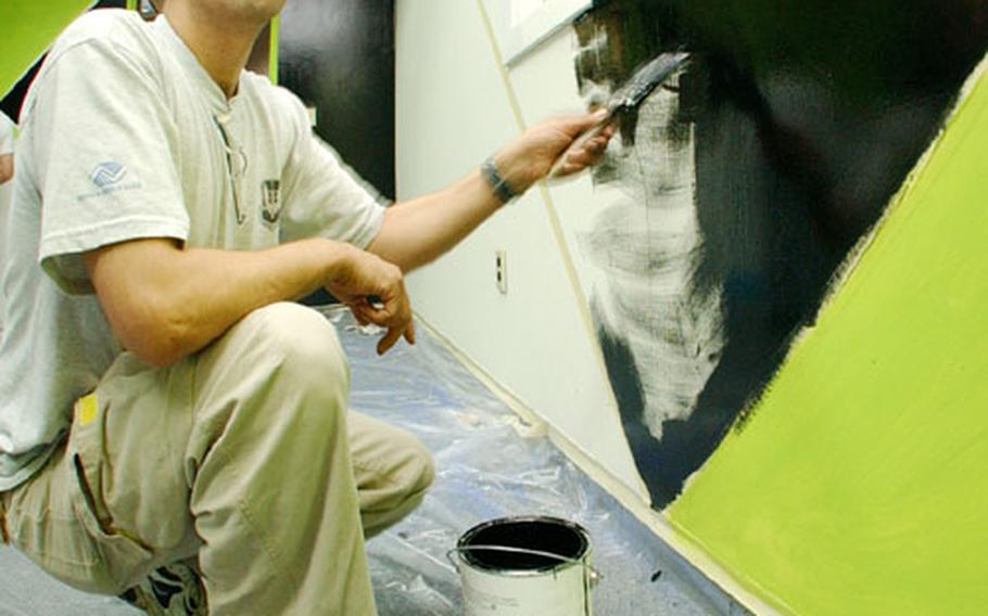 Community center director Ian Foster paints one of the walls of the XBox Room at Lajes Field. U.S. Air Forces in Europe has dished out $200,000 to help build 17 online, multiplayer Xbox gaming centers at 14 bases, both large and small, across the continent.