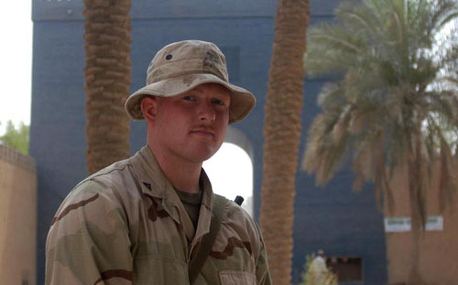 Lance Cpl. Scott Baker, a truck company reservist from Tarentum, Penn., attached to the 1st Marine Division in Iraq, stands inside a replicated Ishtar Gate — the original is in Berlin — the entrance to Babylon. He's seen the ruins of Babylon twice.