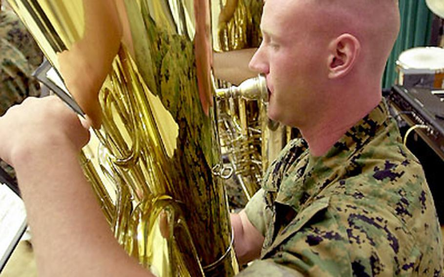 Marine Cpl. Ryan Frost, a tuba player with the 3rd MEF Band on Okinawa, thunders a bass line during a rehearsal.