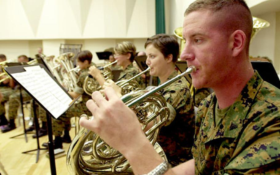 Marine Cpl. Karl Sembroski adds a soft touch on his french horn.