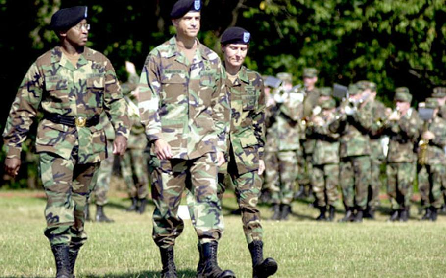 From left, Brig. Gen. Elder Granger, Col. David Rubenstein and Col. Rhonda Cornum, inspect the formation assembled for a Change of Command ceremony in Kaiserslautern, Germany, on Friday.