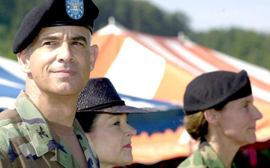 Col. David Rubenstein, left, watches over his troops with his wife, Patricia, in Kaiserslautern, Germany, on Friday as he hands over his command to Col. Rhonda Cornum, far right. Rubenstein commanded Landstuhl Regional Medical Center for three years.