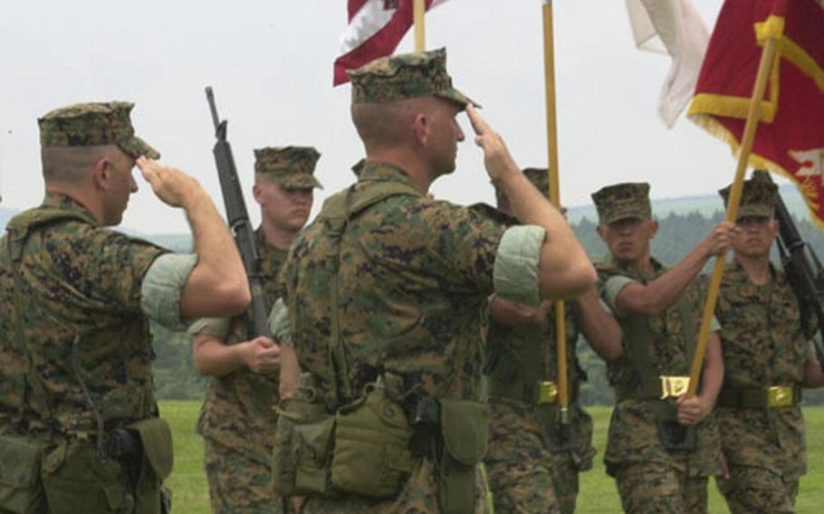 Col. Henry Donigan III and the new Commanding Officer of Camp Fuji, Col. John J. Jackson, salute the flag during the pass and review at the change of command.
