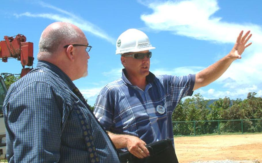 Project manager Delane Rivenbark, right, goes over construction plans for the Cottages at Oura Wan Beach with Ray Welch, the MCCS camp coordinator for Camp Schwab.