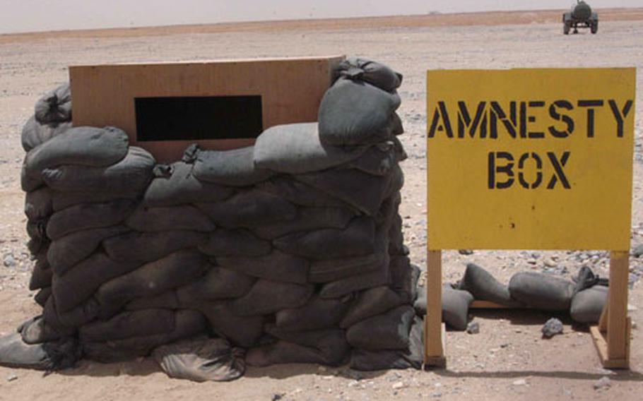 An amnesty box at Camp Arifjan, Kuwait, gives returning soldiers a place to deposit prohibited items they might have brought back from Iraq.